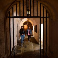 Two women walk down the centre hall of York Castle Prison