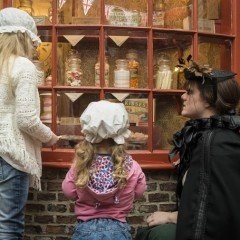 Two young girls meet a Victorian resident on Kirkgate at York Castle Museum. Picture by Skywall.