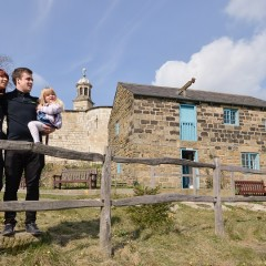 A family stand outside Raindale Mill at York Castle Museum (Image Mike Cowling)