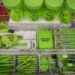 Green stationery items in museum shop