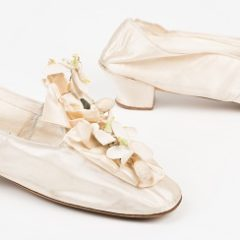 A pair of wedding slippers in ivory silk satin with 1 ½ inch 'knock-on' heels.