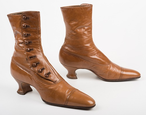 04b8683d891 A pair of brown leather boots. The boots have a heel and buttons running  up. A pair of brown leather boots. The boots have a heel and buttons  running up