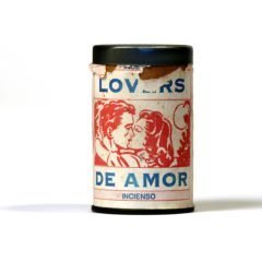 An old-fashioned can. The can has the words 'Lovers. De Amor. Incienso' and a picture of two people kissing on it.