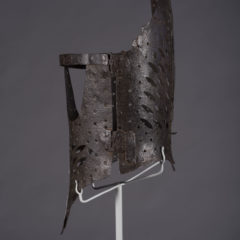 Side view of a pair of stays made from iron