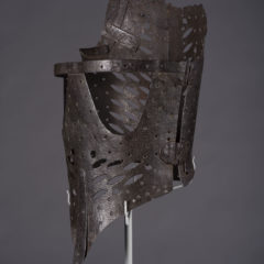 Side view of a pair of stays made from iron.