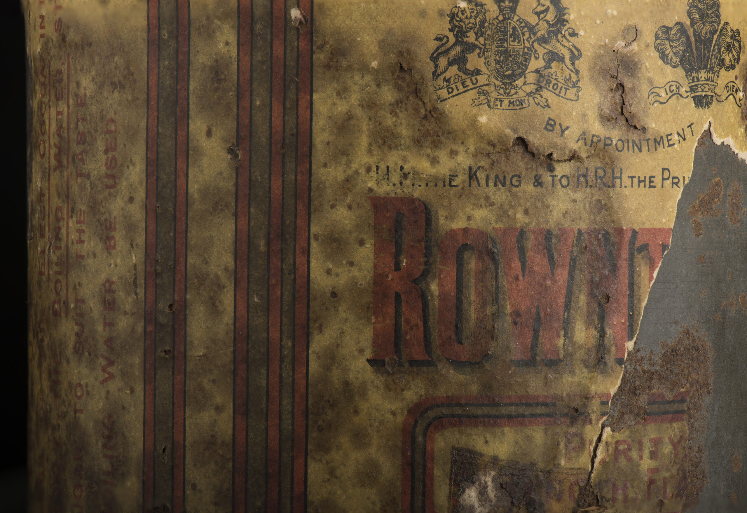 Close up of Rowntree logo on Shackleton's Cocoa Tin.