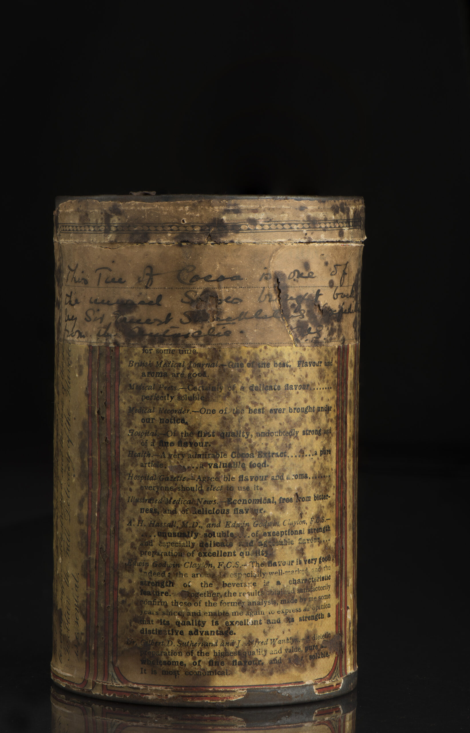 Reverse of Shackleton's Cocoa Tin showing handwritten note.