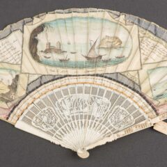 Front of Italian fan, painted with tourist images. There are three scenes of Italy painted to look like watercolour postcards. The images depict the Bay of Naples with ships sailing and Mt Vesuvius.